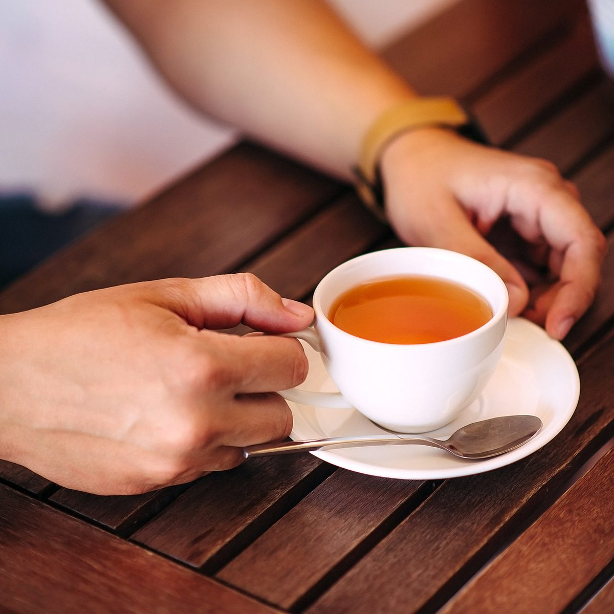 Close-up male hands holding a cup of tea; Shutterstock ID 419110399; Job (TFH, TOH, RD, BNB, CWM, CM): Taste of Home