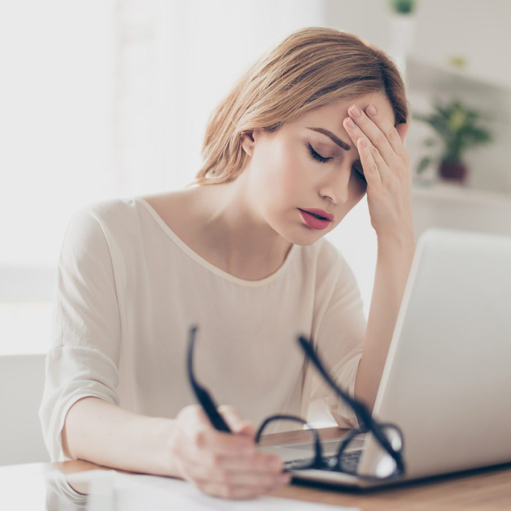 Overworked businesswoman suffering from headache and thinking how to end work.; Shutterstock ID 609134846; Job (TFH, TOH, RD, BNB, CWM, CM): Taste of Home