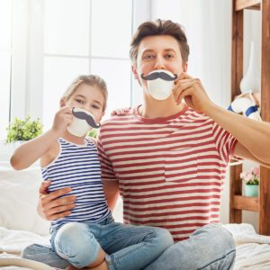 Happy father's day! Dad and his child daughter are playing and having fun together. Beautiful funny girl and daddy have mustaches on cups. Family holidays and togetherness.; Shutterstock ID 632773559; Job (TFH, TOH, RD, BNB, CWM, CM): Taste of Home