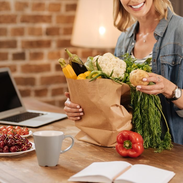 Charming neat woman examining contents of the bag; Shutterstock ID 687220006; Job (TFH, TOH, RD, BNB, CWM, CM): TOH
