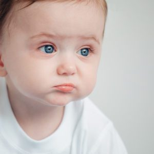 The baby cries and calls mum from a bed; Shutterstock ID 716634532; Job (TFH, TOH, RD, BNB, CWM, CM): TOH