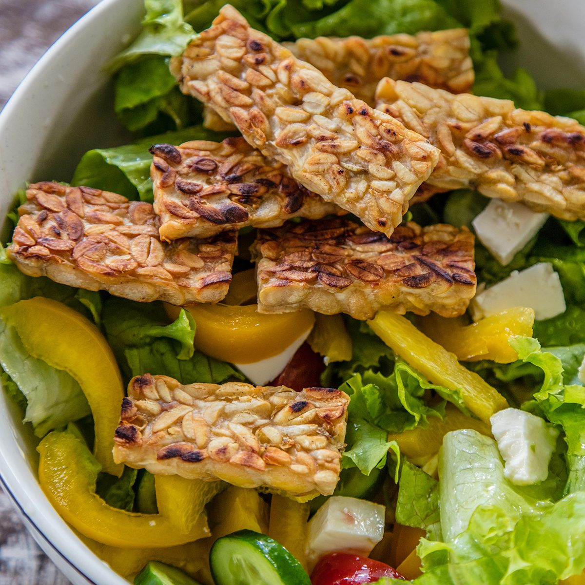 Raw vegetable and lettuce salad with tempe goreng, fried tempeh,