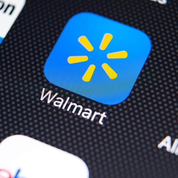 Walmart application icon on Apple iPhone X screen close-up.