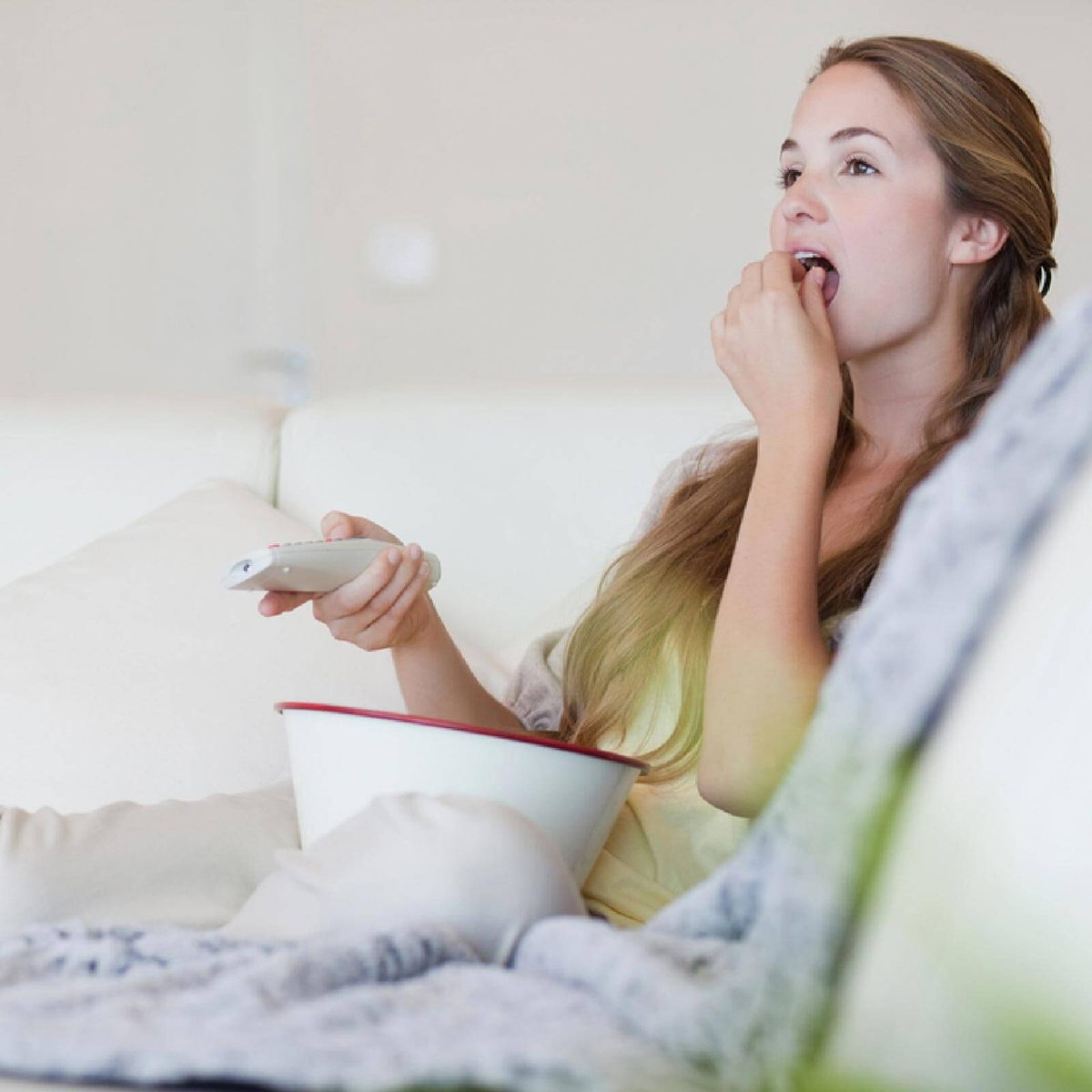 Eating popcorn in front of a tv