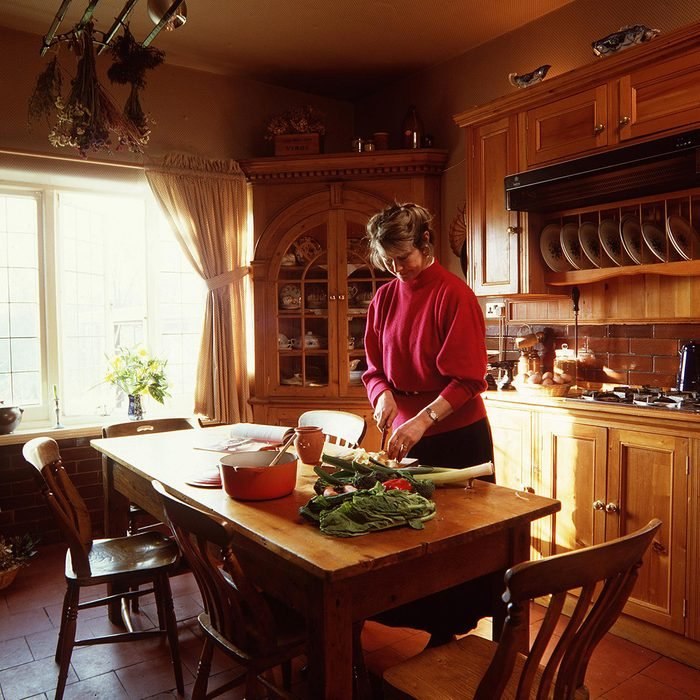 WOMAN IN THE KITCHEN PREPARING FOOD