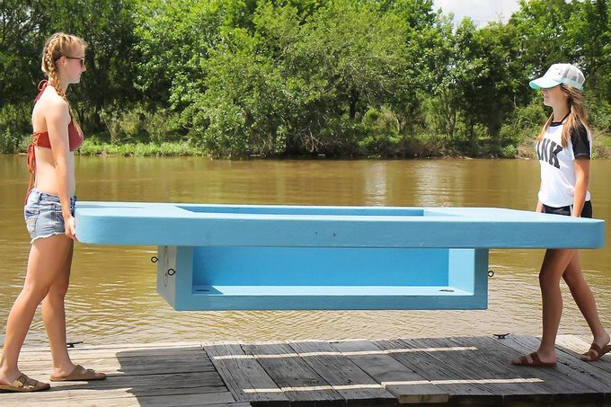 kids holding a floating picnic table