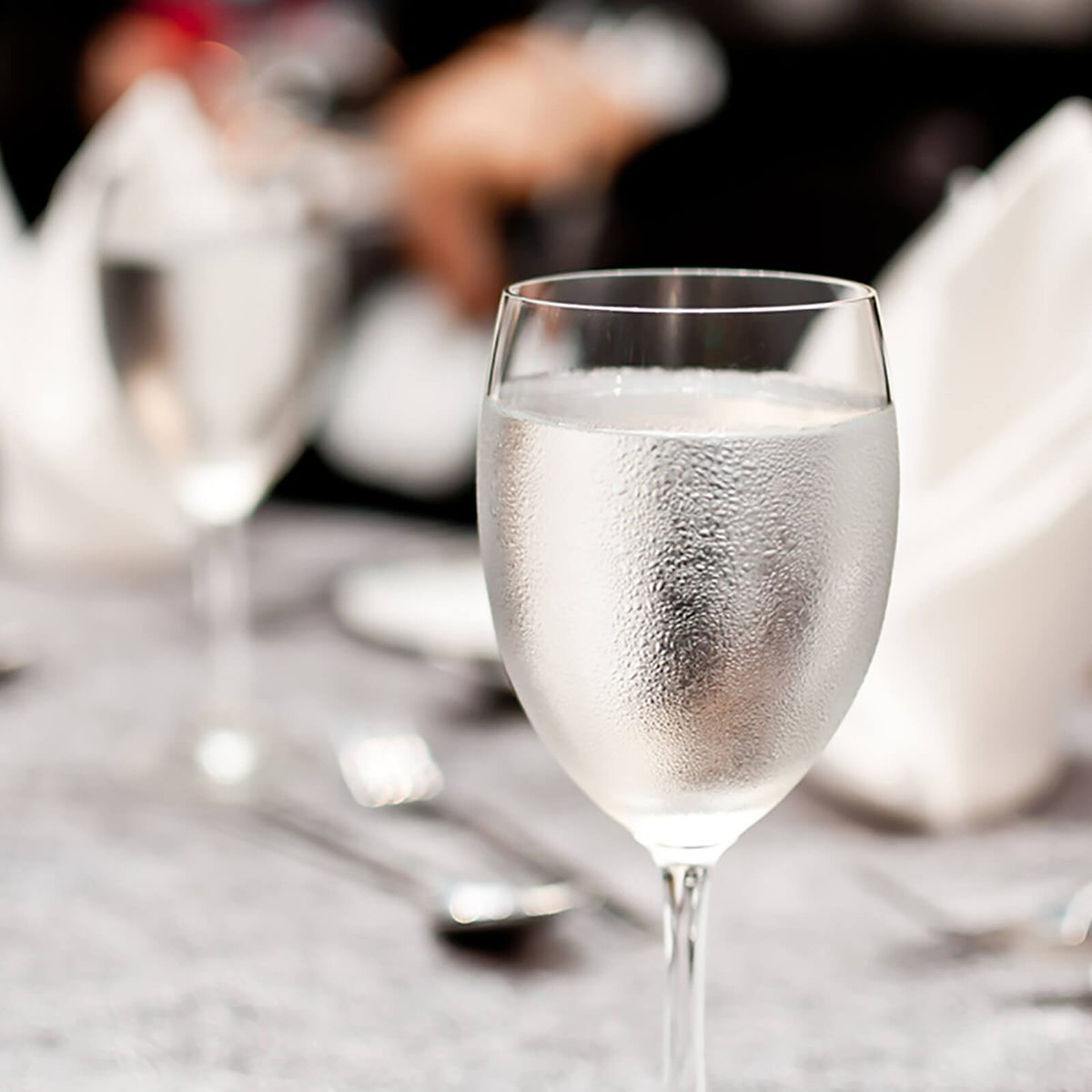 Glass of water on luxury table setting for dining