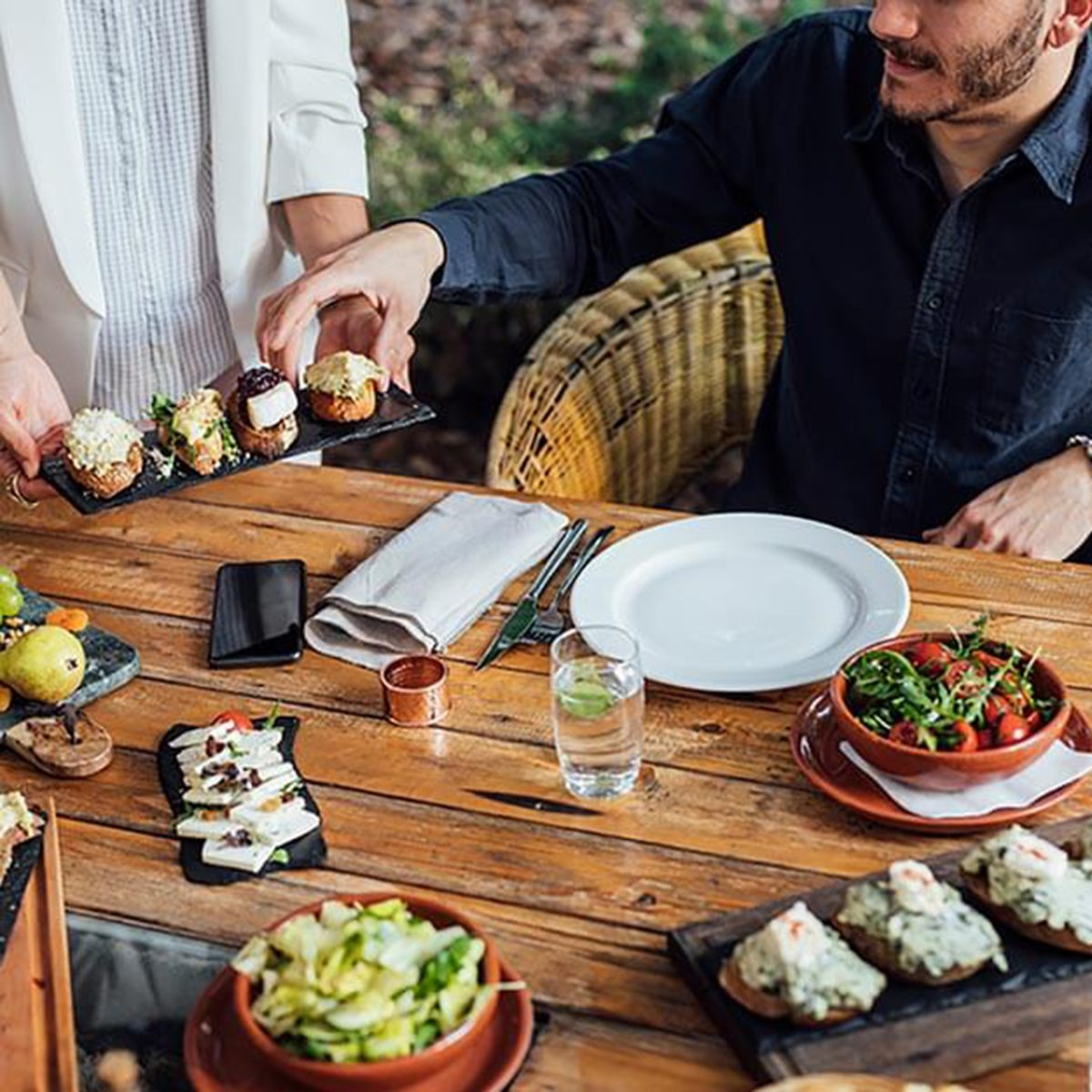 Man reaching for appetizers