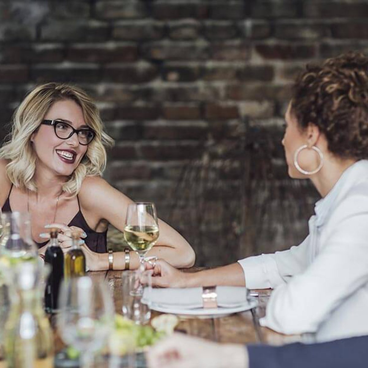 Woman smiling at each other over dinner
