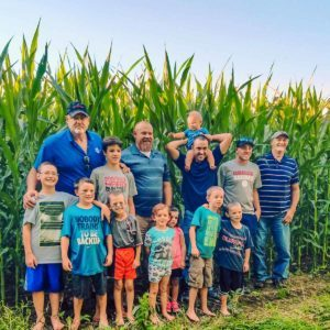 Family in front of corn