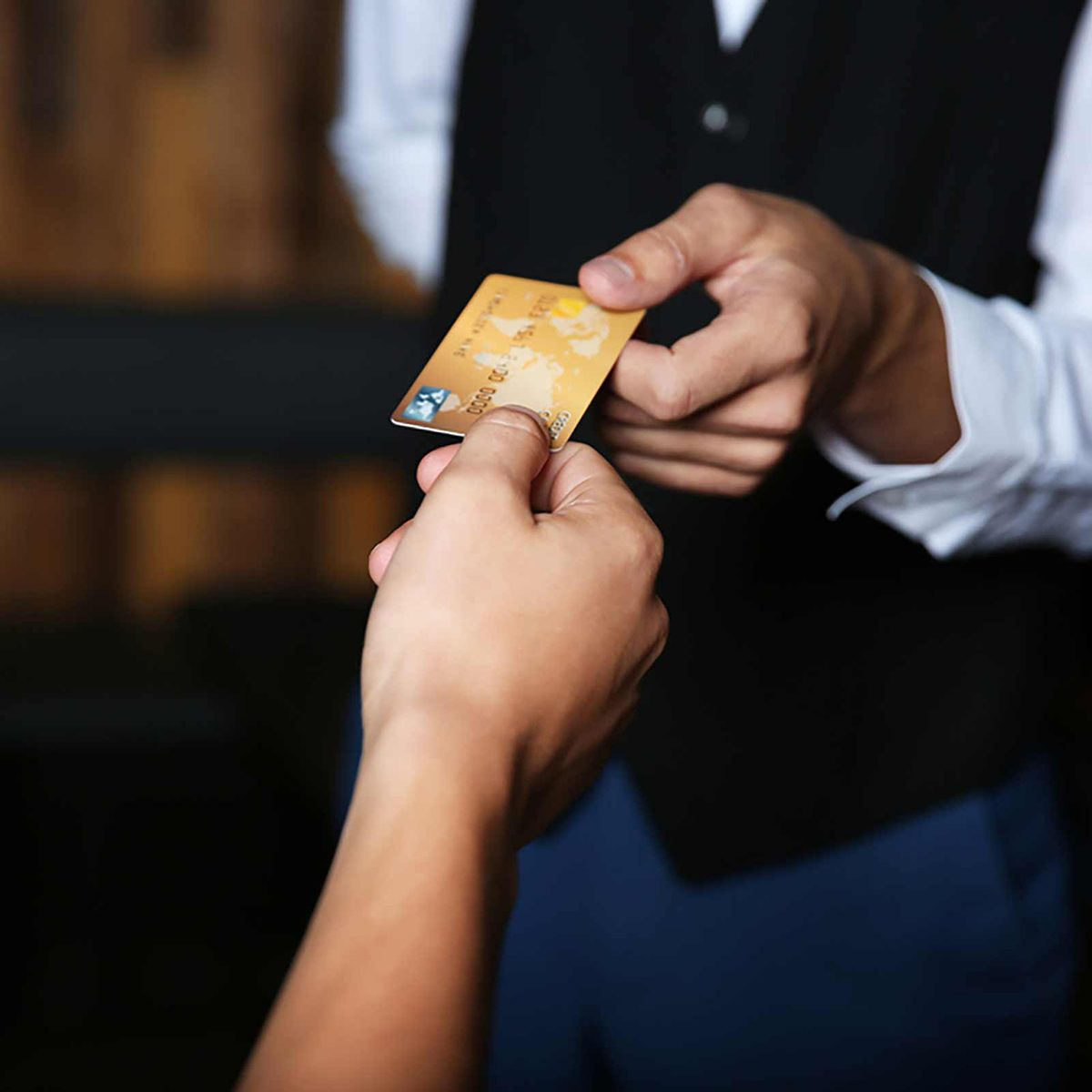 Handing a credit card to a waiter