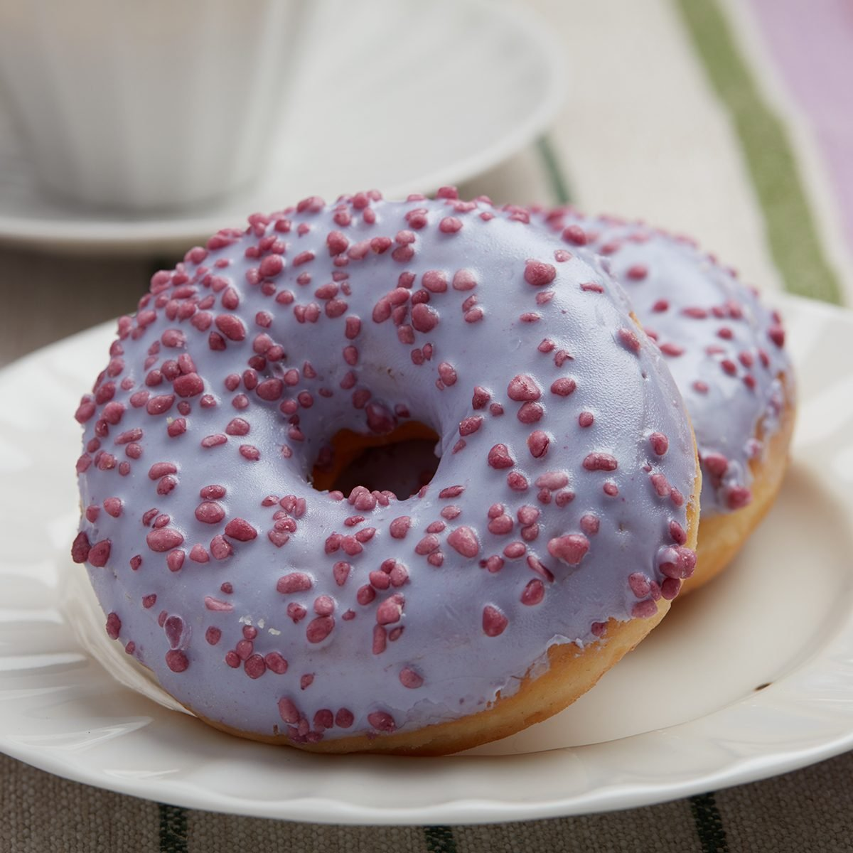 Two lavender donuts closeup