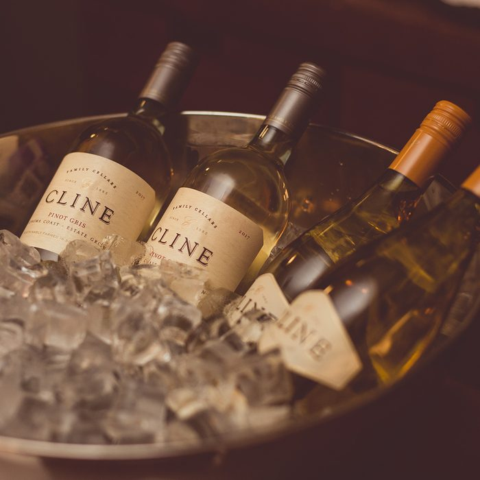 bottles of Cline Vionier and Pino Gris wine in an ice bowl.