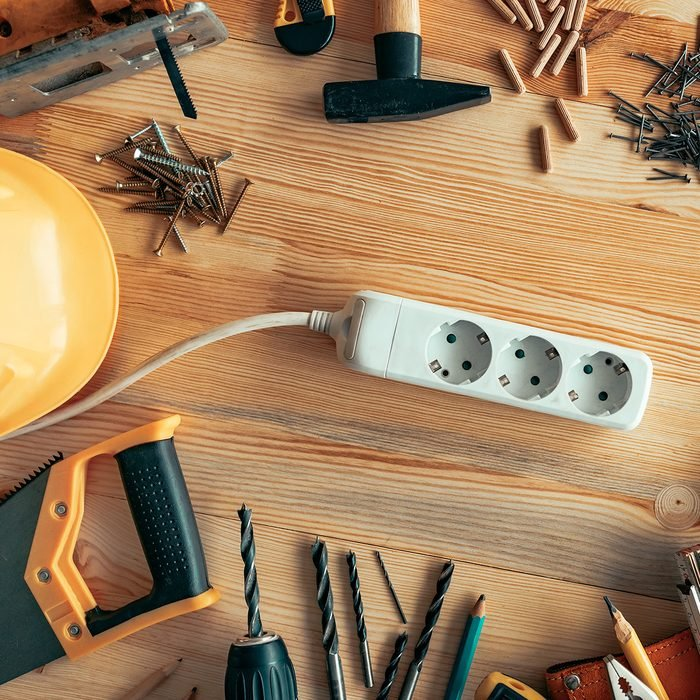 Power strip extension cord on carpentry woodwork woodwork desk