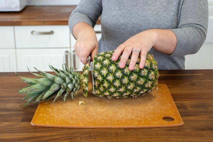 cutting pineapple