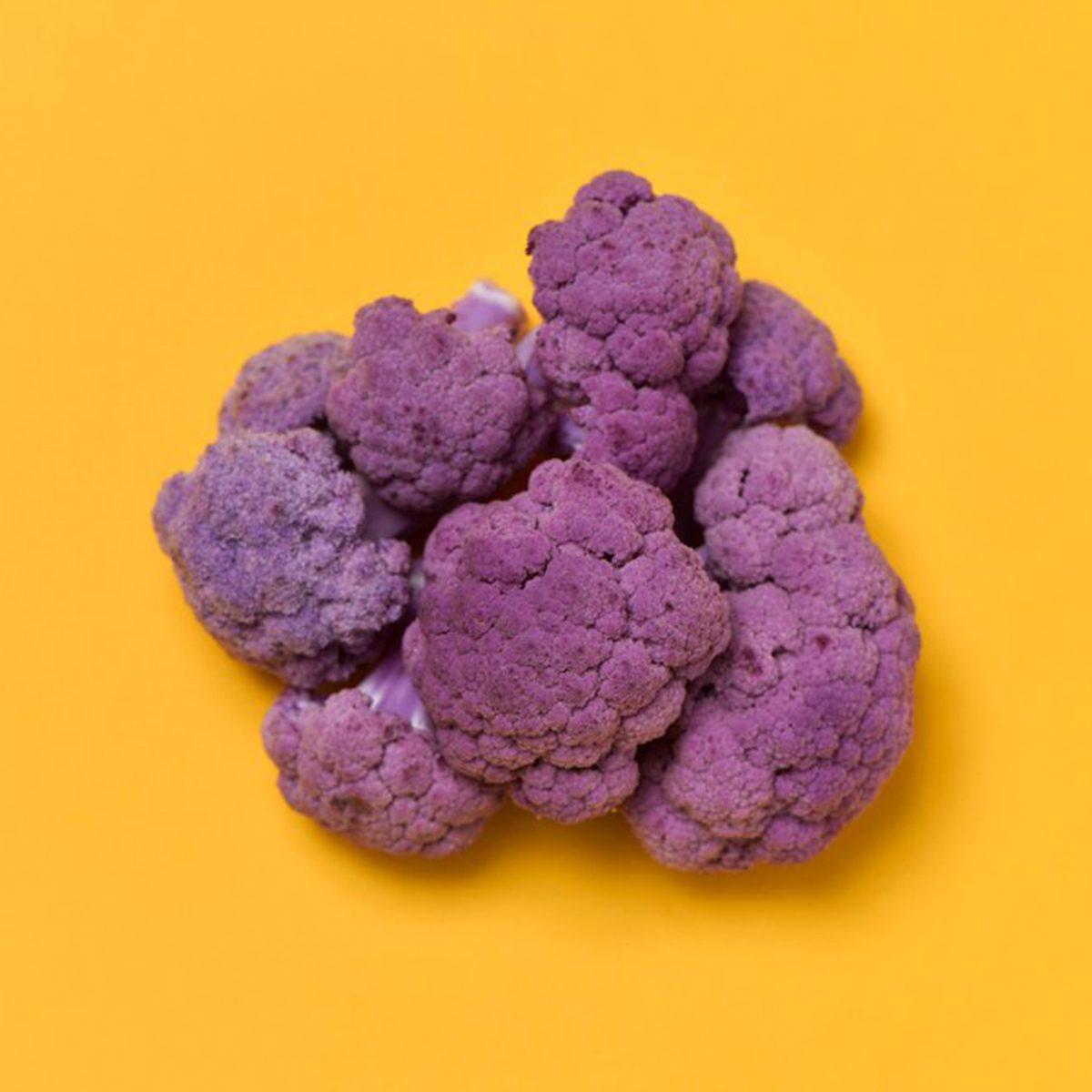 Purple cauliflower on orange background