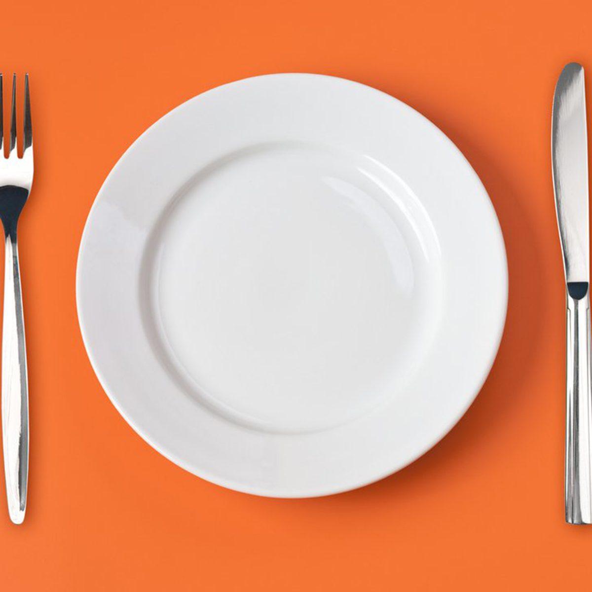 Dinner plate on an orange background