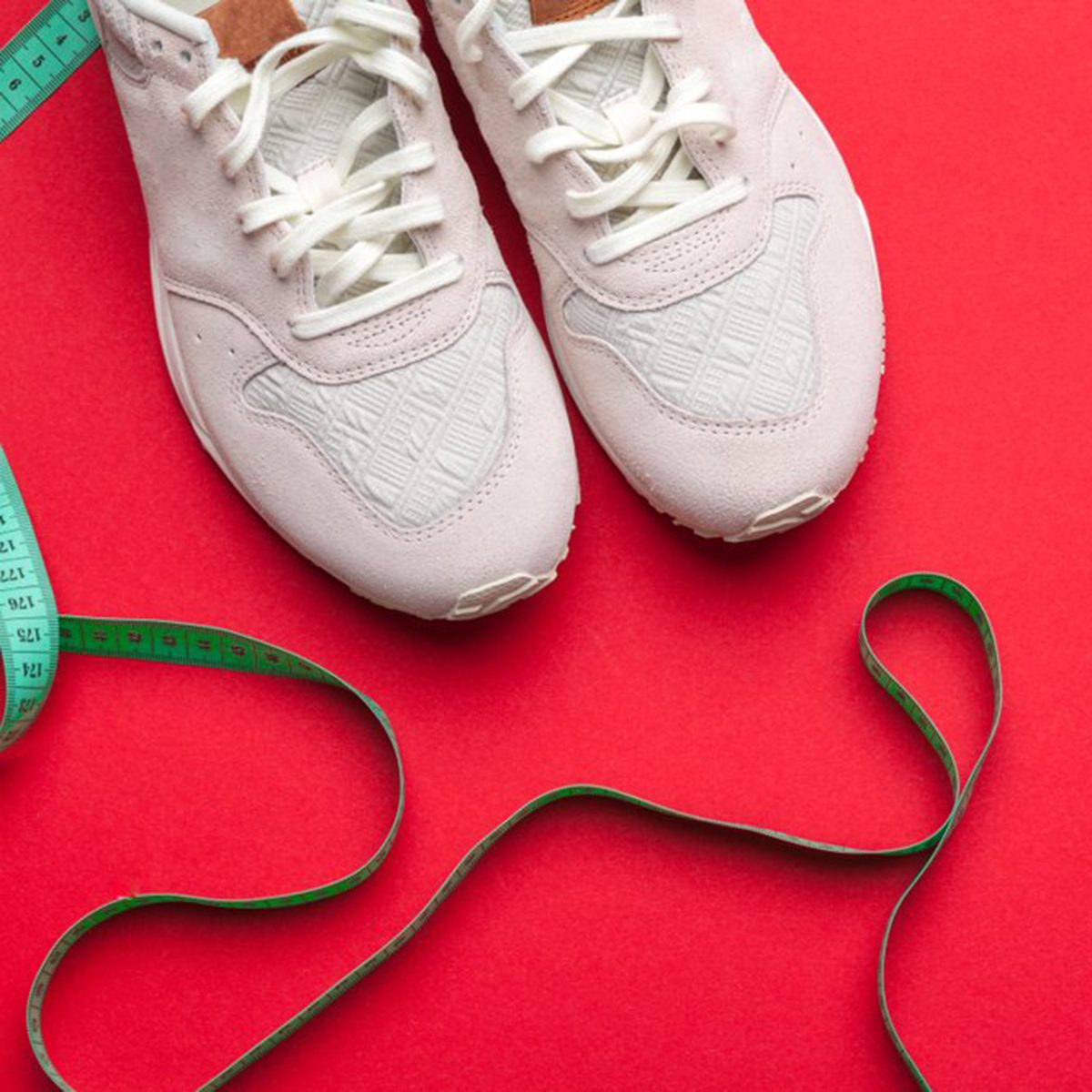 Tennis shoes on a red background
