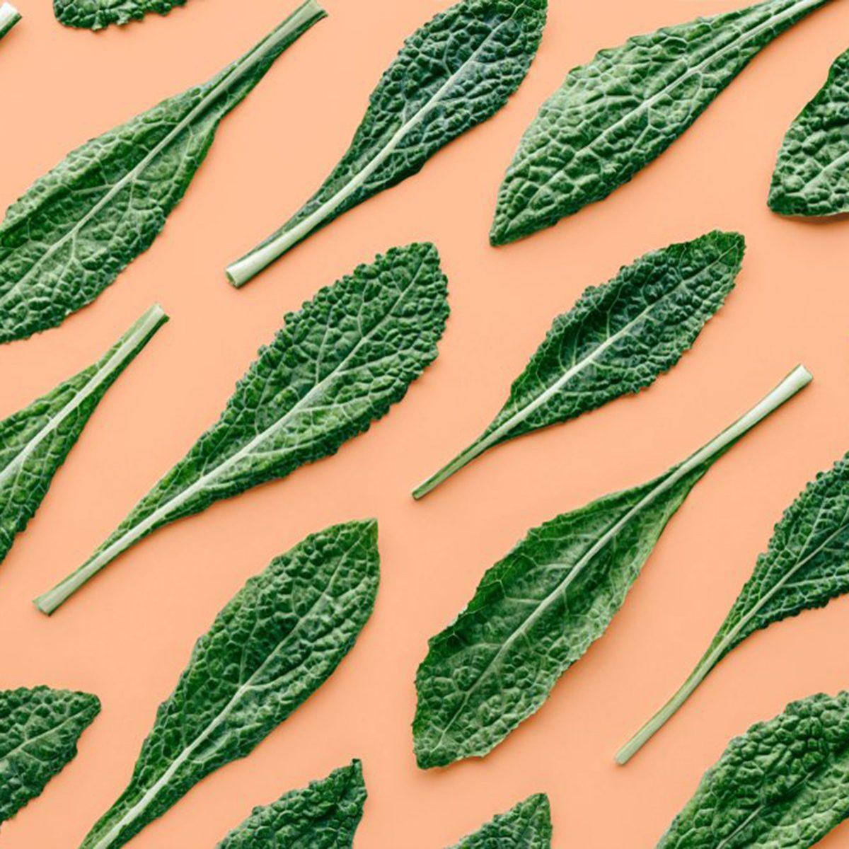Kale leaves on an orange background