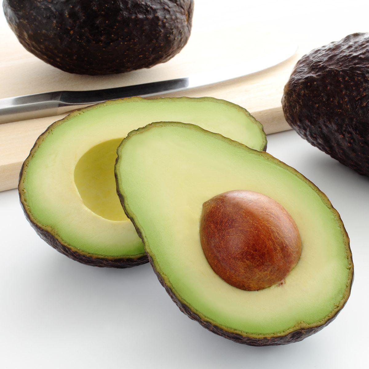 Cut fresh avocado on cutting board/ Avocado; Shutterstock ID 663927946; Job (TFH, TOH, RD, BNB, CWM, CM): TOH