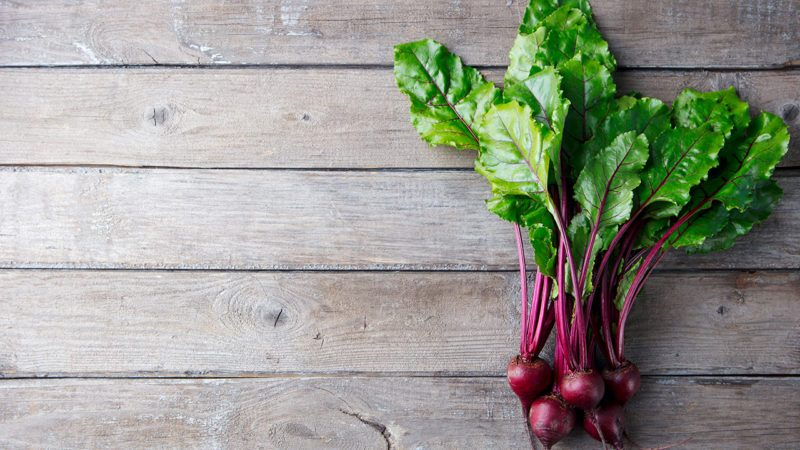 Fresh organic beet, beetroot on grey rustic wooden background.