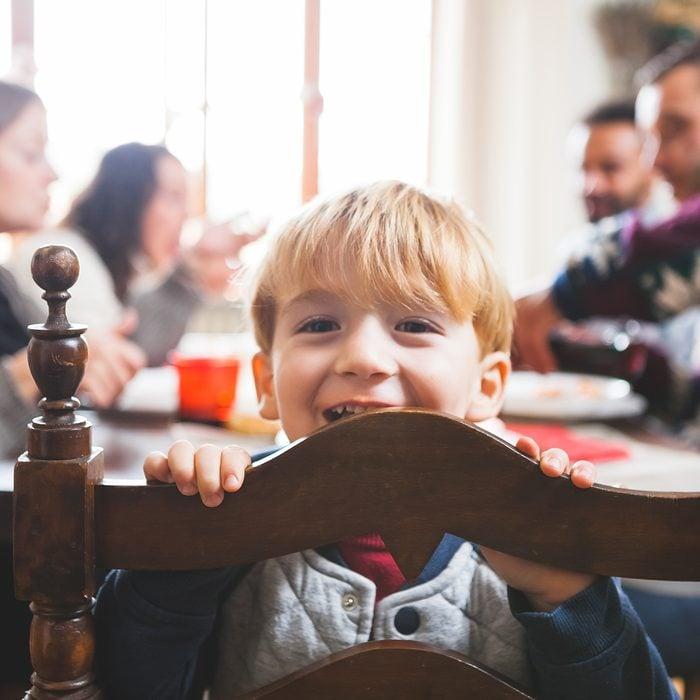 Cute Playful Preschooler Child at Christmas Dinner;