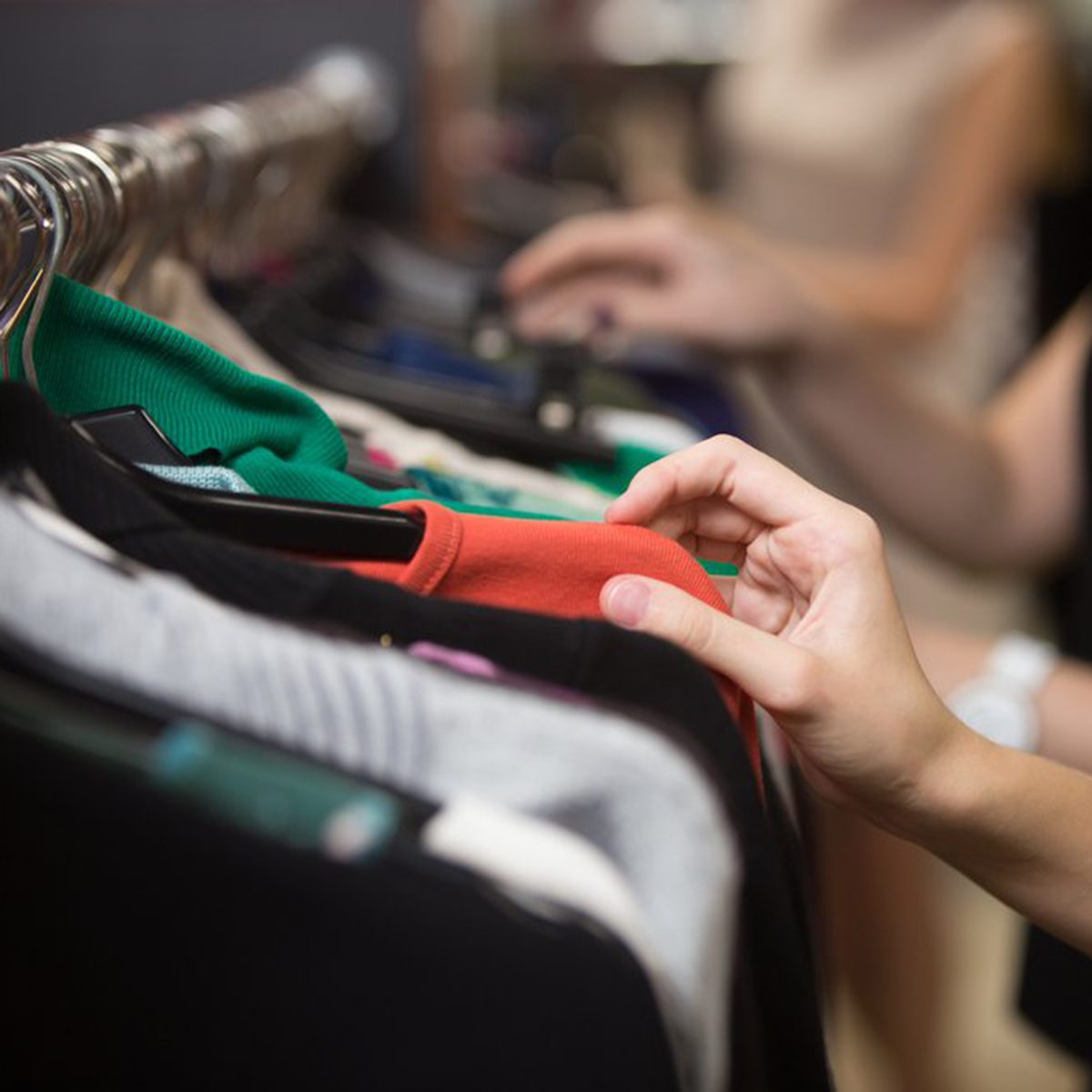 Choosing clothing from a rack