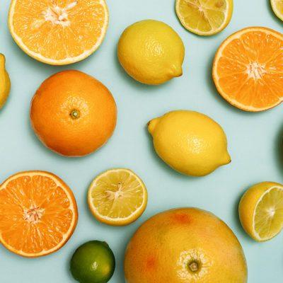 Citrus fruits sliced, lemons, oranges, tangerines and grapefruit.