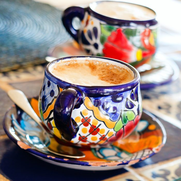Cappuccino in traditional colorful mexican pottery cups;