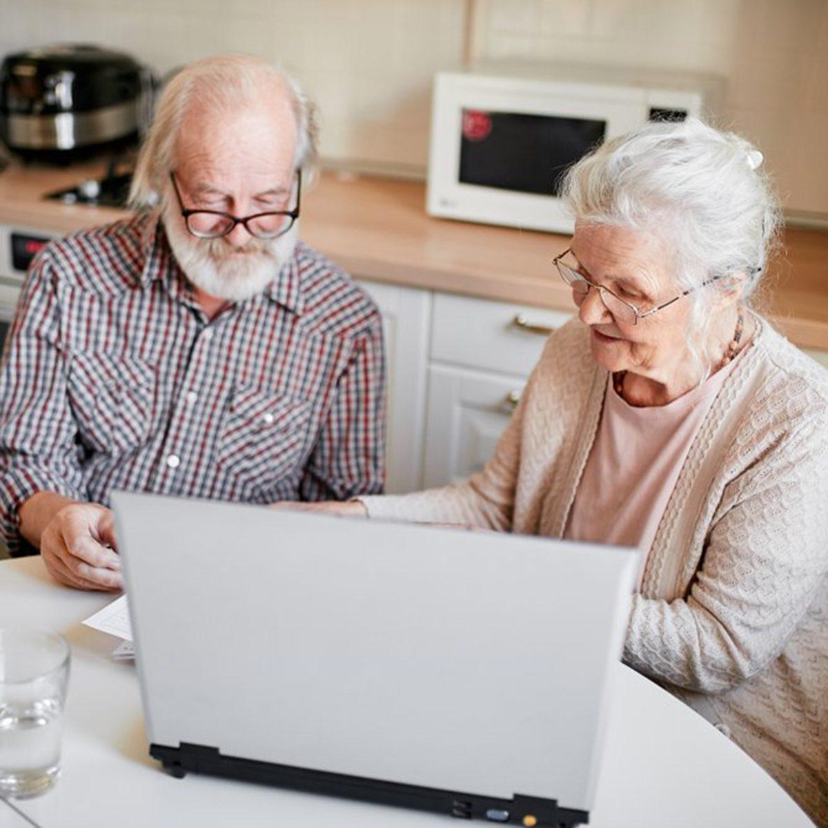 Elderly couple on laptop