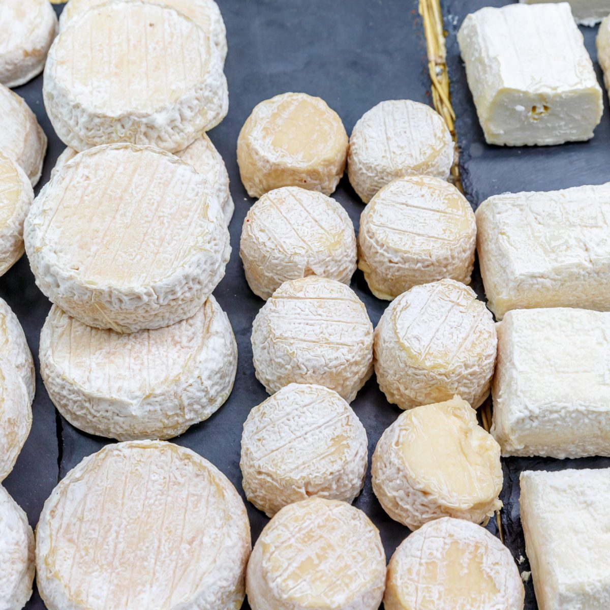 Goat and Sheep Cheese Display at the Farmer's Market; Shutterstock ID 1407689732; Job (TFH, TOH, RD, BNB, CWM, CM): TOH Farmers Market Food Safety