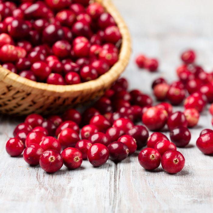 Harvest fresh red cranberries in wicker basket