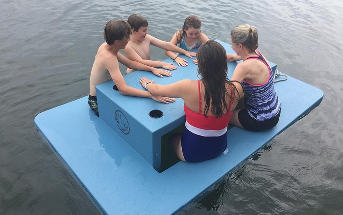 Kids eating at floating picnic table