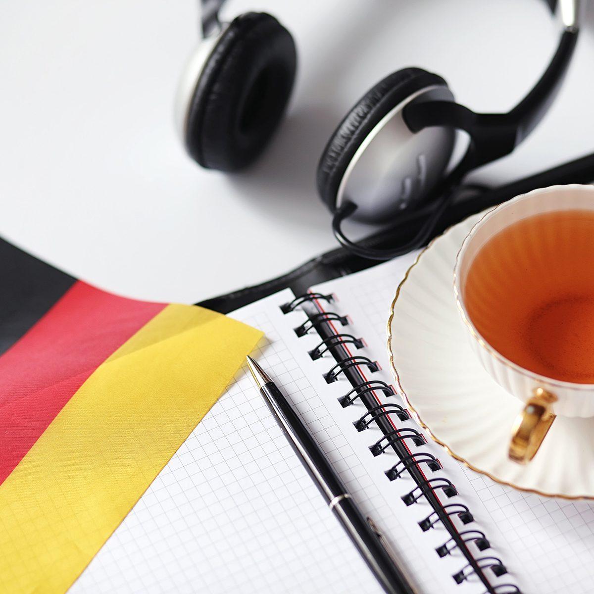 Headphones, tea, and flag on a desk