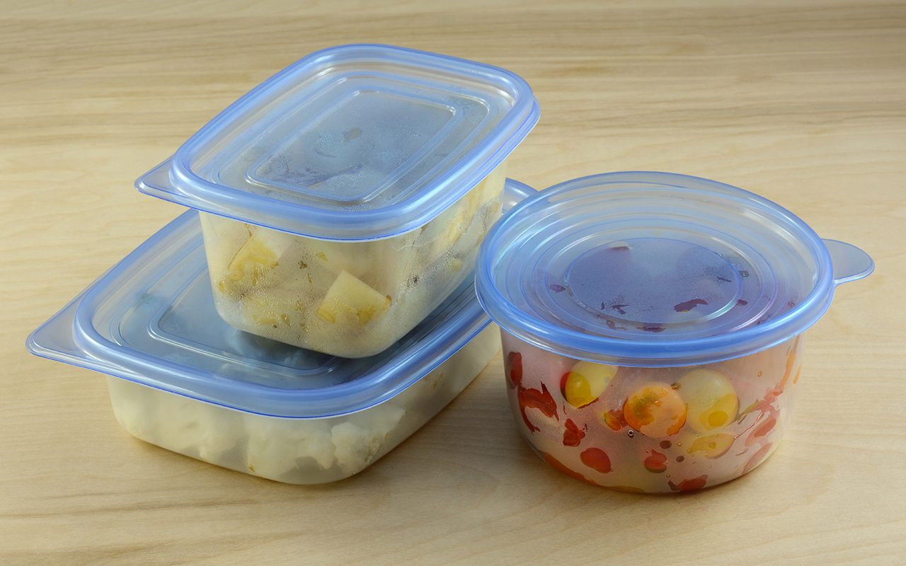 Chopped dinner ingredients of cauliflower, potatoes and cherry tomatoes in plastic refrigerator storage containers prepared in advance for quicker cooking during week after work