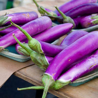 Multiple Japanese Eggplants at the Farmers Market