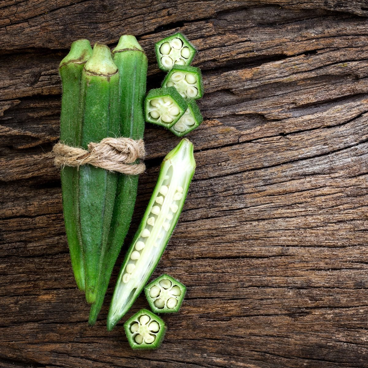 Close up the fresh okra on wooden plate