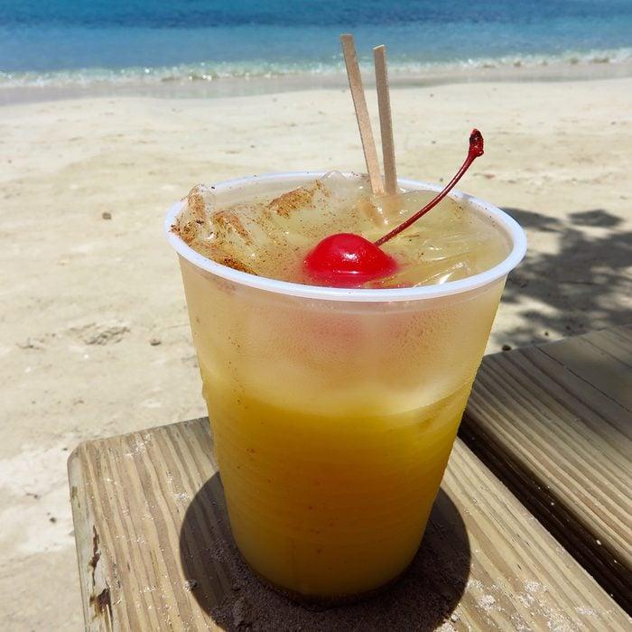 Painkiller fruity tropical rum drink on the beach in St. John, USVI, Virgin Islands, Caribbean
