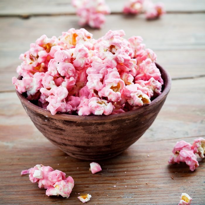 Pink chocolate pop corn in brown bow