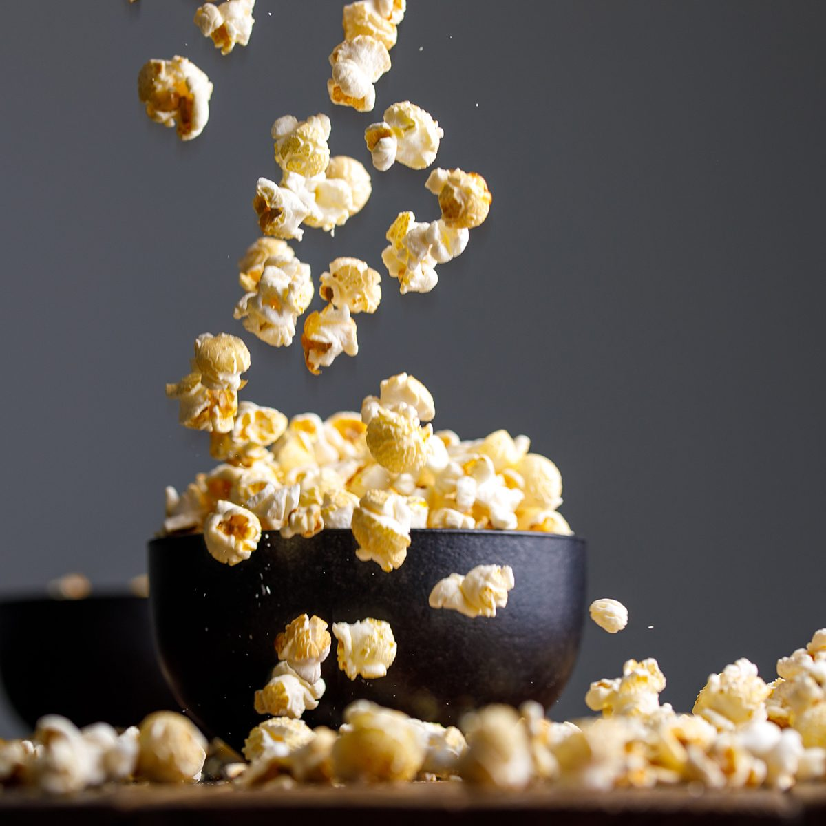 Popcorn falling into a bowl from above