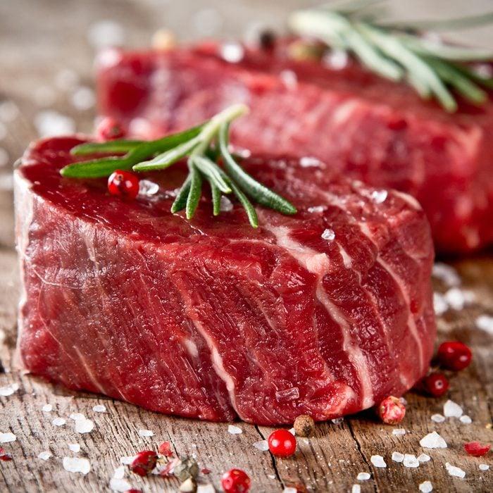 Fresh raw beef steak on wood