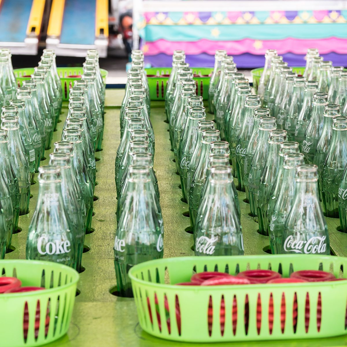 Ring toss carnival, fair game using coca cola bottles.