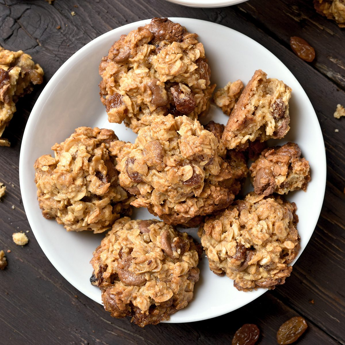 Healthy oatmeal cookies on plate over wooden background, top view; Shutterstock ID 740216929; Job (TFH, TOH, RD, BNB, CWM, CM): TOH