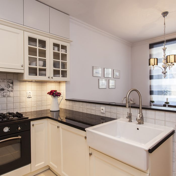 New stylish kitchen with small dining room;