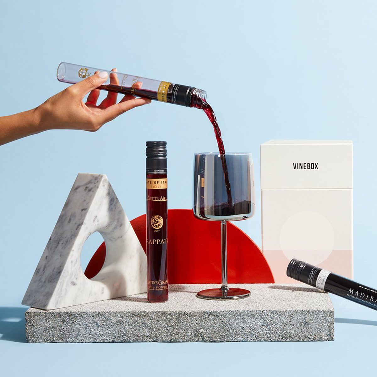 vine box hero shot pouring wine into glass packaging