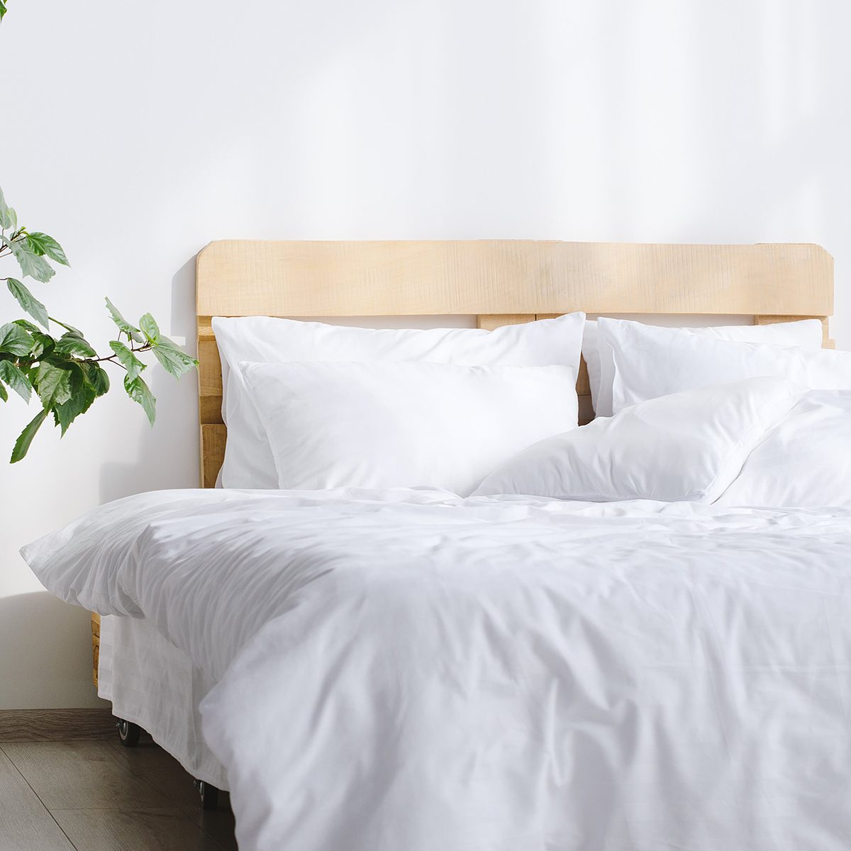 Bed with white sheets