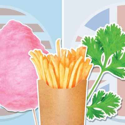 cotton candy, french fries and arugula on blue backgroung with american and Britain flag in background