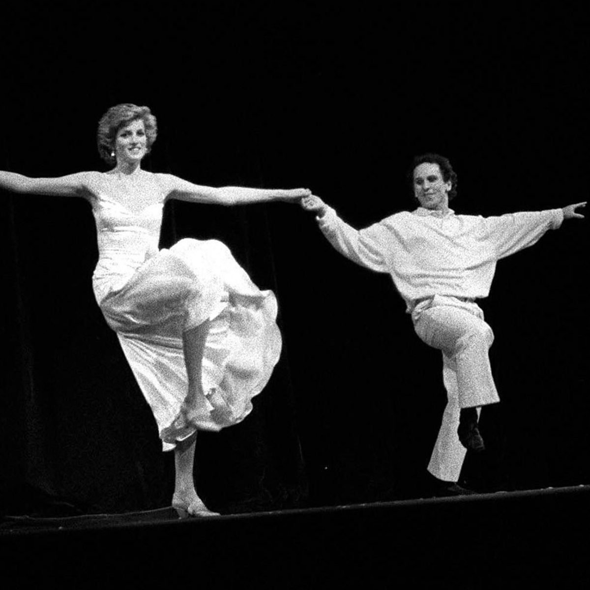 Black and white photo of two people dancing