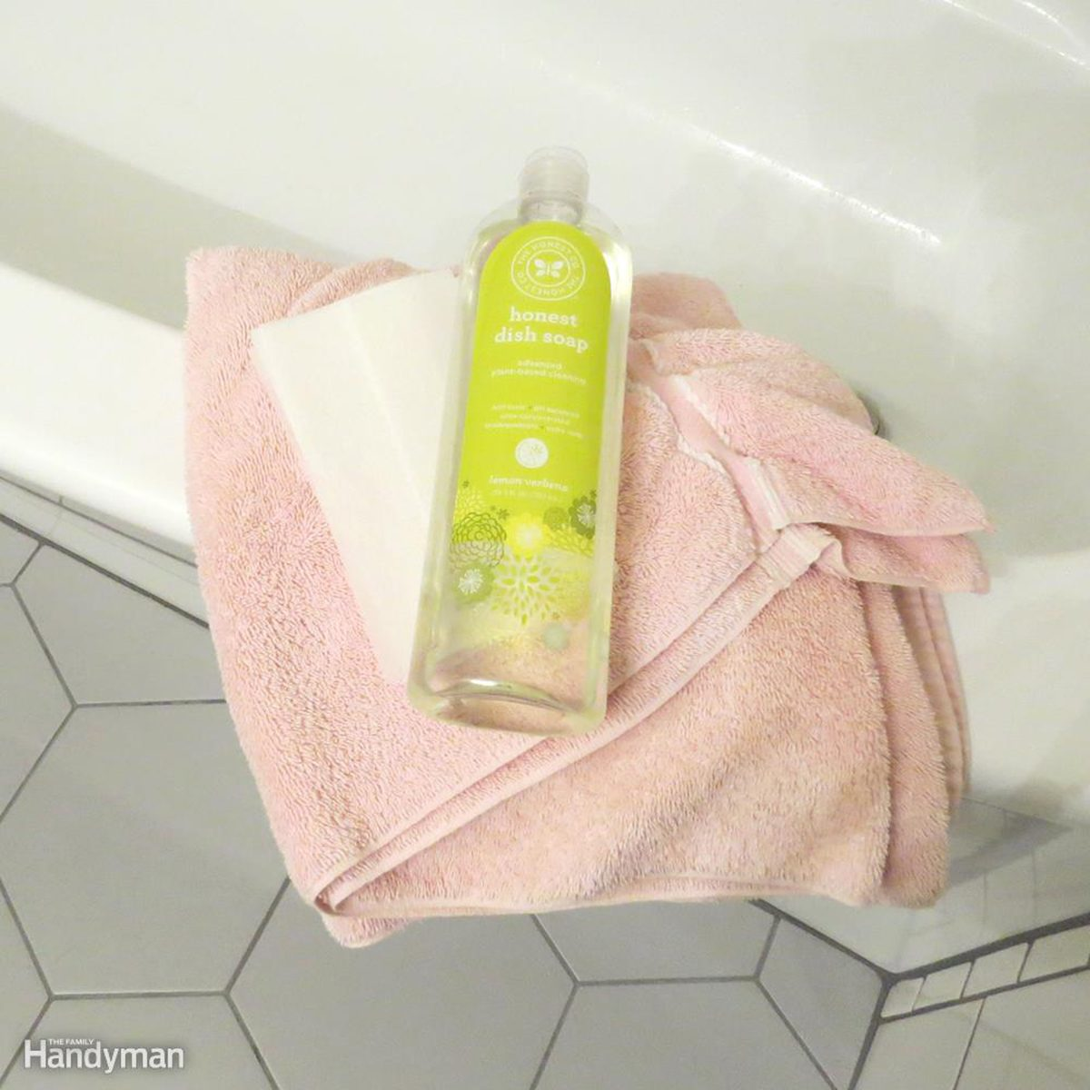 Bottle of cleaning on pink towel