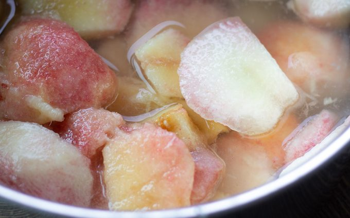 Simmering cubed peaches